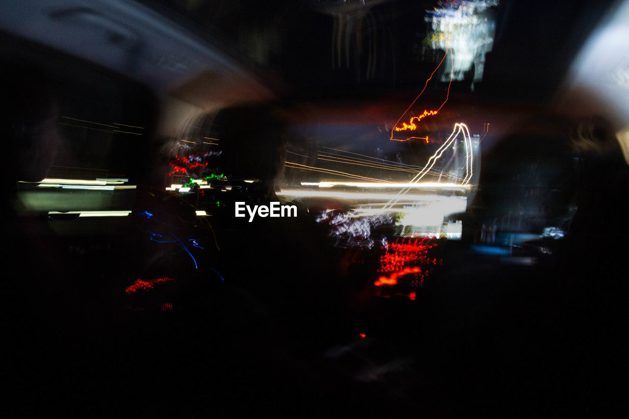 car, transportation, land vehicle, speed, mode of transport, car interior, road, motion, vehicle interior, illuminated, traffic, long exposure, blurred motion, driving, night, light trail, car point of view, windshield, street, high street, no people, city, outdoors