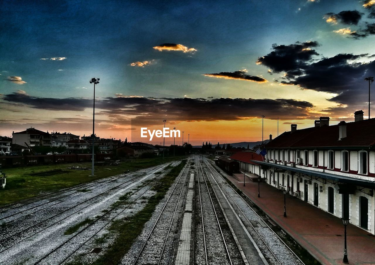 sunset, railroad track, sky, rail transportation, transportation, no people, cloud - sky, outdoors, nature, built structure, day