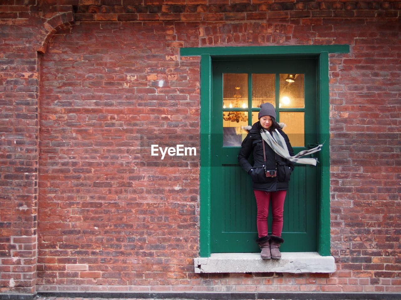 Woman standing at doorway