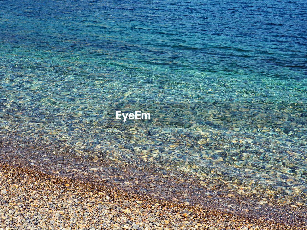 water, sea, beauty in nature, tranquility, day, no people, nature, blue, waterfront, tranquil scene, scenics - nature, land, beach, rippled, idyllic, transparent, high angle view, backgrounds, outdoors, clean, shallow, purity, turquoise colored