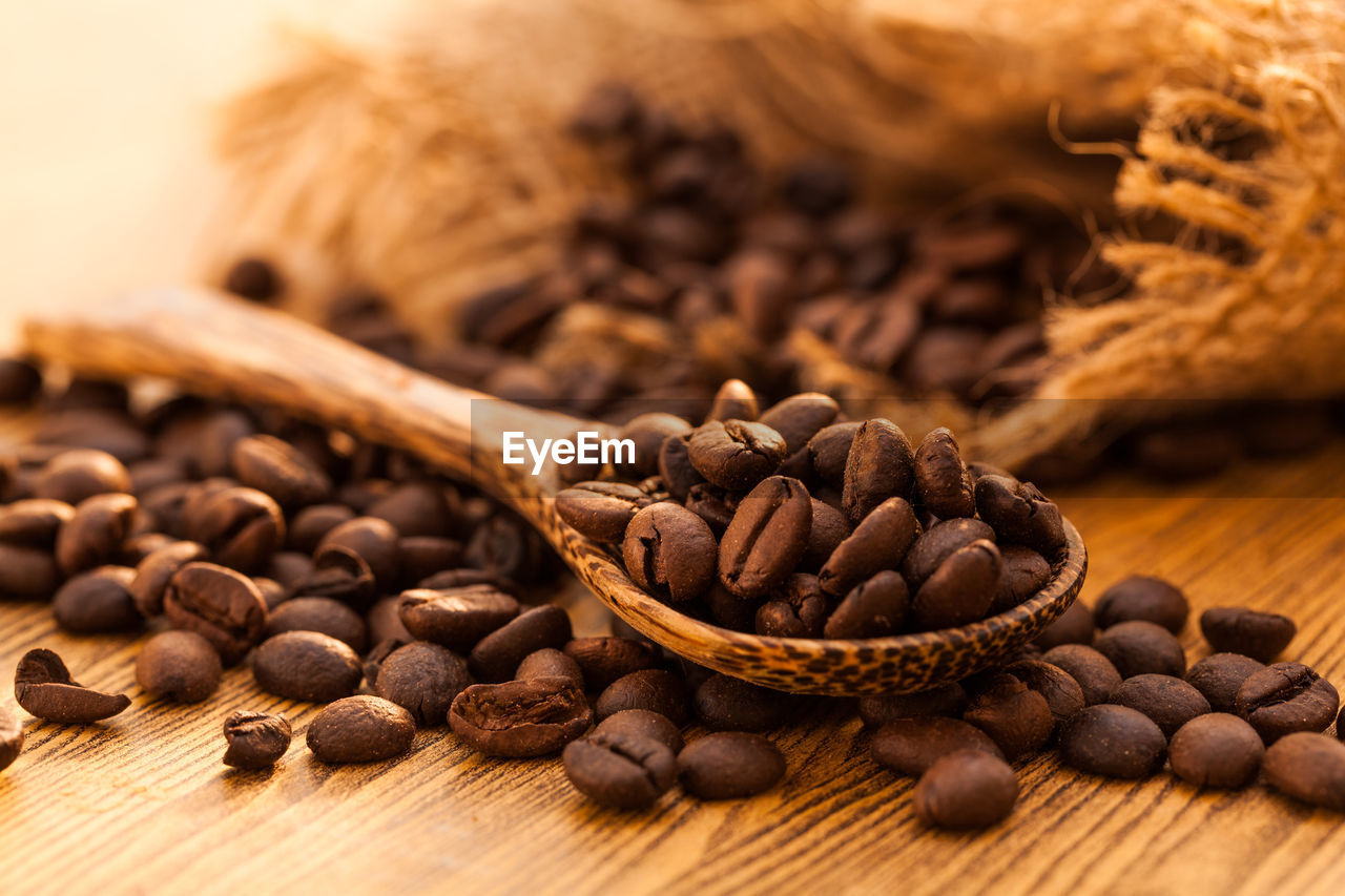 food and drink, food, brown, still life, freshness, coffee - drink, roasted coffee bean, table, close-up, coffee, indoors, wood - material, spice, no people, large group of objects, selective focus, ingredient, spoon, wellbeing, eating utensil, caffeine