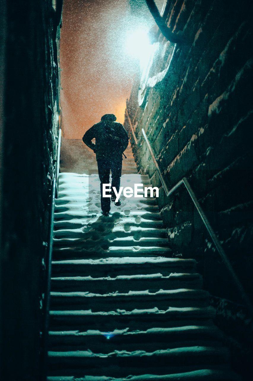 Silhouette Man Walking On Stairs