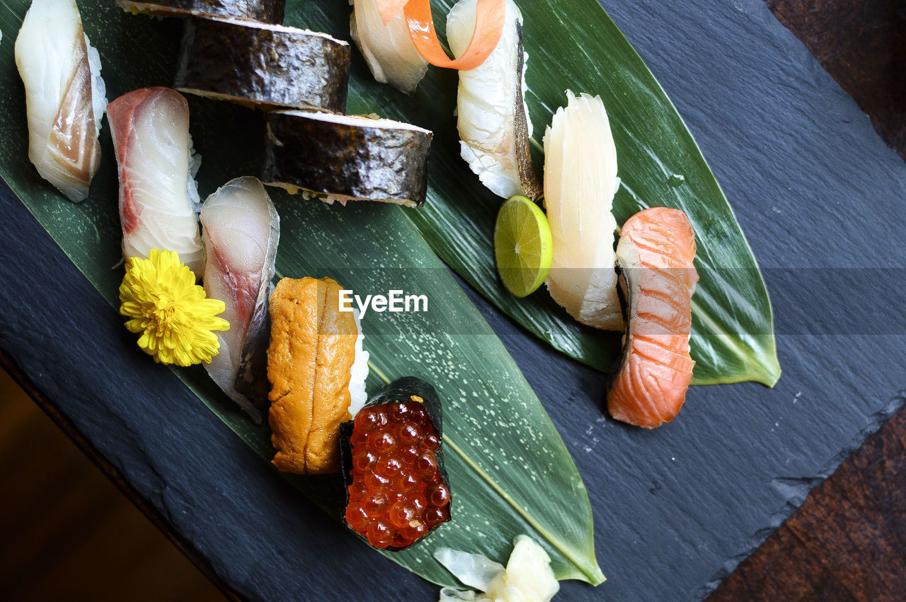 food, food and drink, freshness, healthy eating, leaf, high angle view, seafood, vegetable, wellbeing, no people, plant part, indoors, asian food, still life, fruit, preparation, fish, raw food, table, leaves, japanese food, tray, chopped