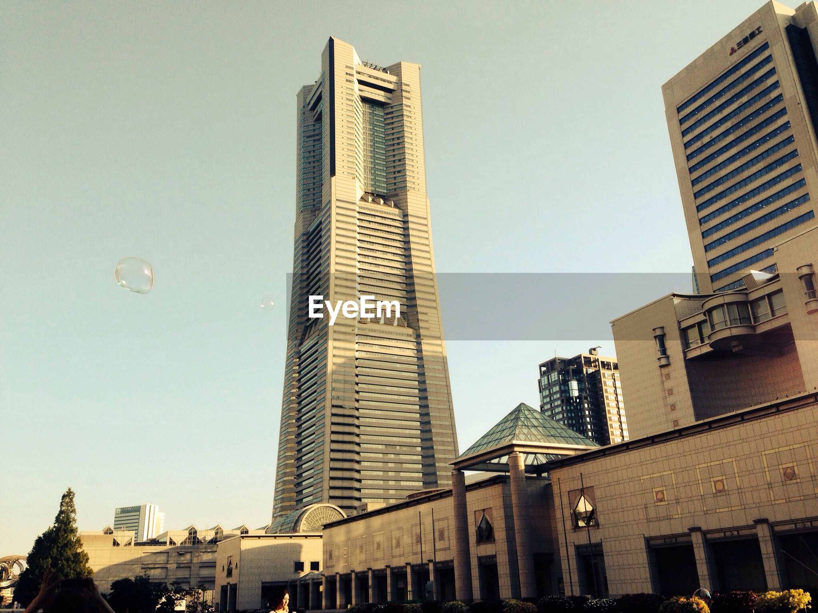 building exterior, architecture, built structure, skyscraper, tall - high, low angle view, city, tower, modern, clear sky, office building, tall, building, capital cities, city life, financial district, travel destinations, famous place, day, outdoors