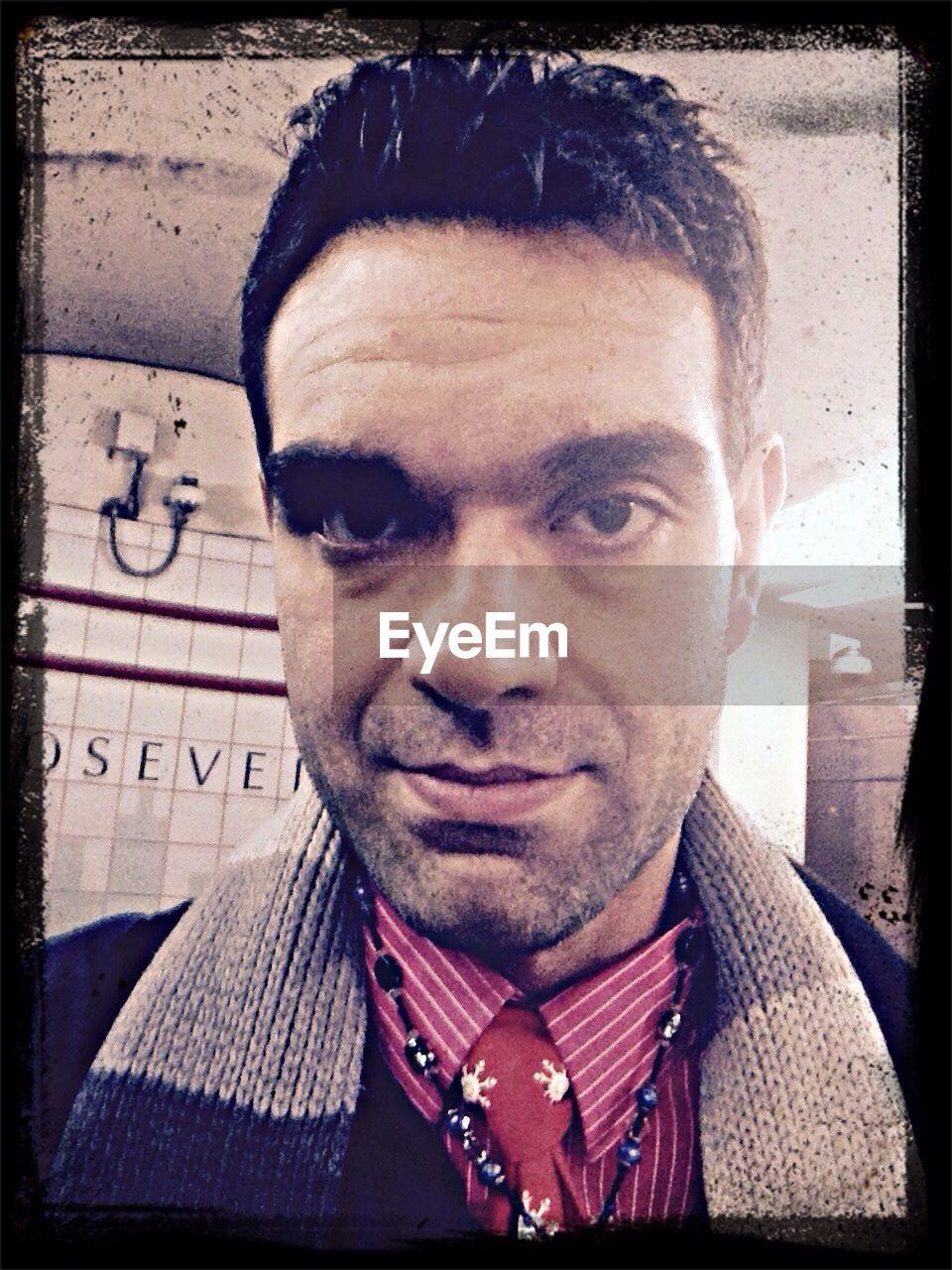 Portrait of man at subway station