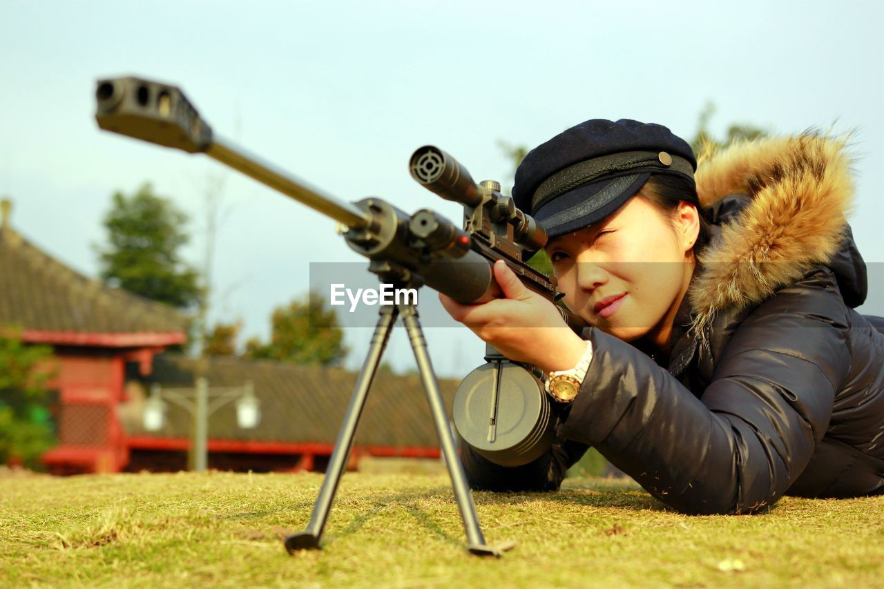Woman With Sniper On Field