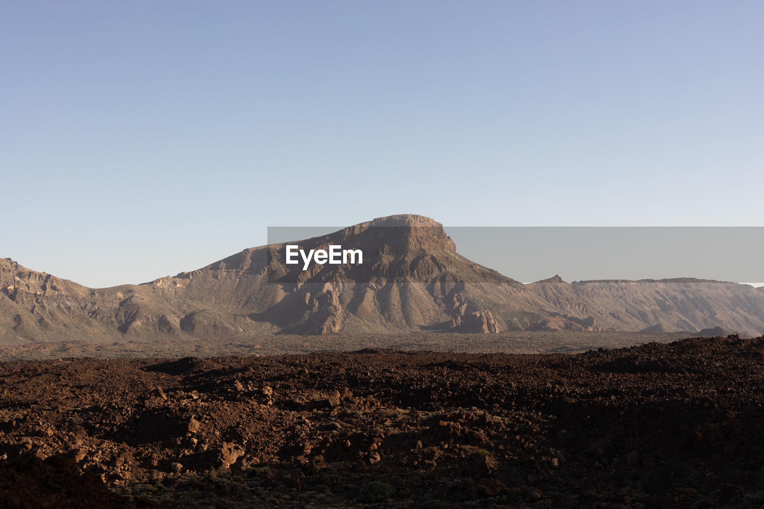 SCENIC VIEW OF VOLCANIC LANDSCAPE AGAINST CLEAR SKY
