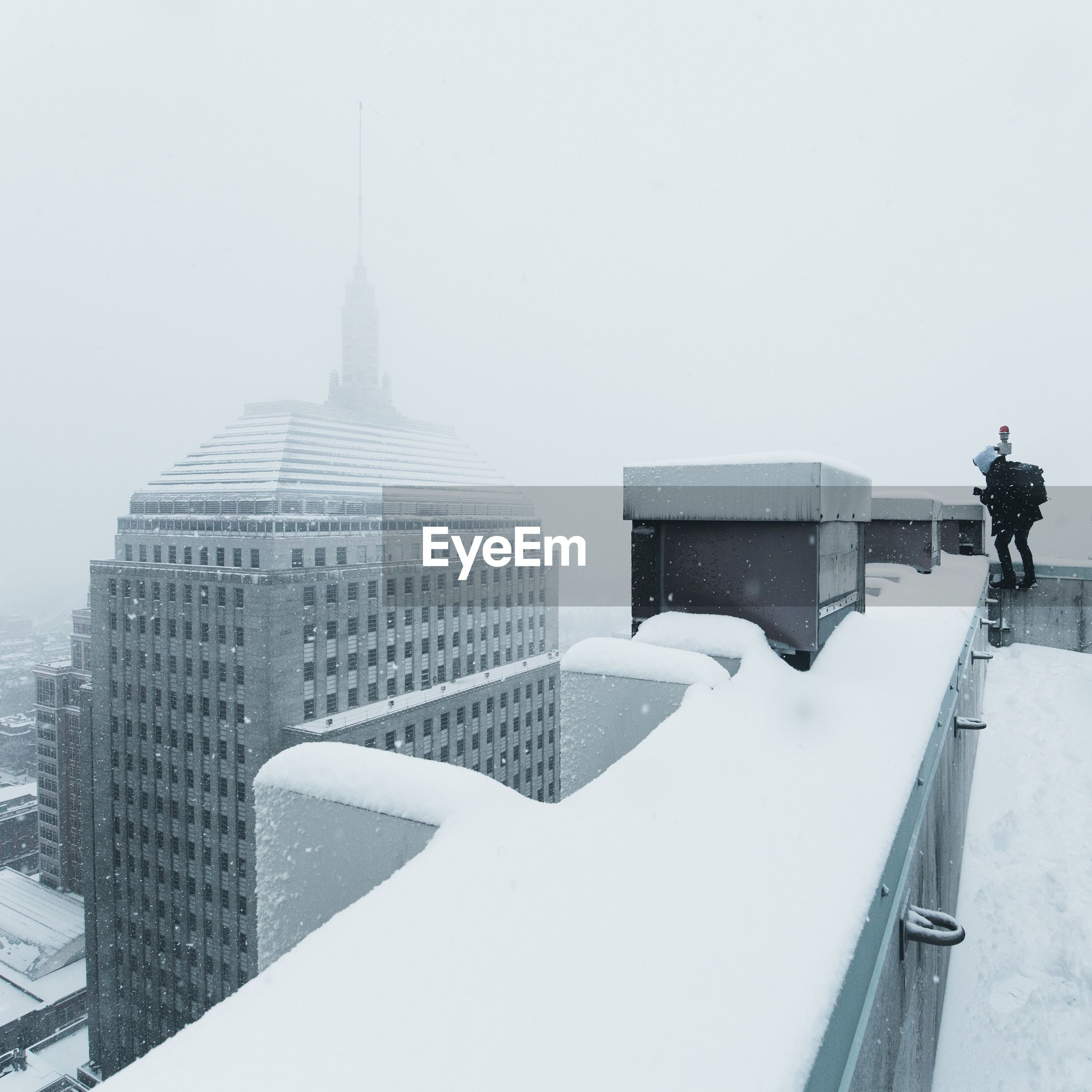 View of buildings in city during winter