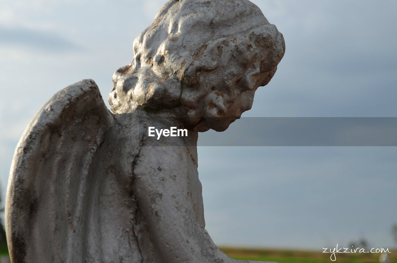 statue, sculpture, human representation, focus on foreground, sky, day, outdoors, no people, close-up