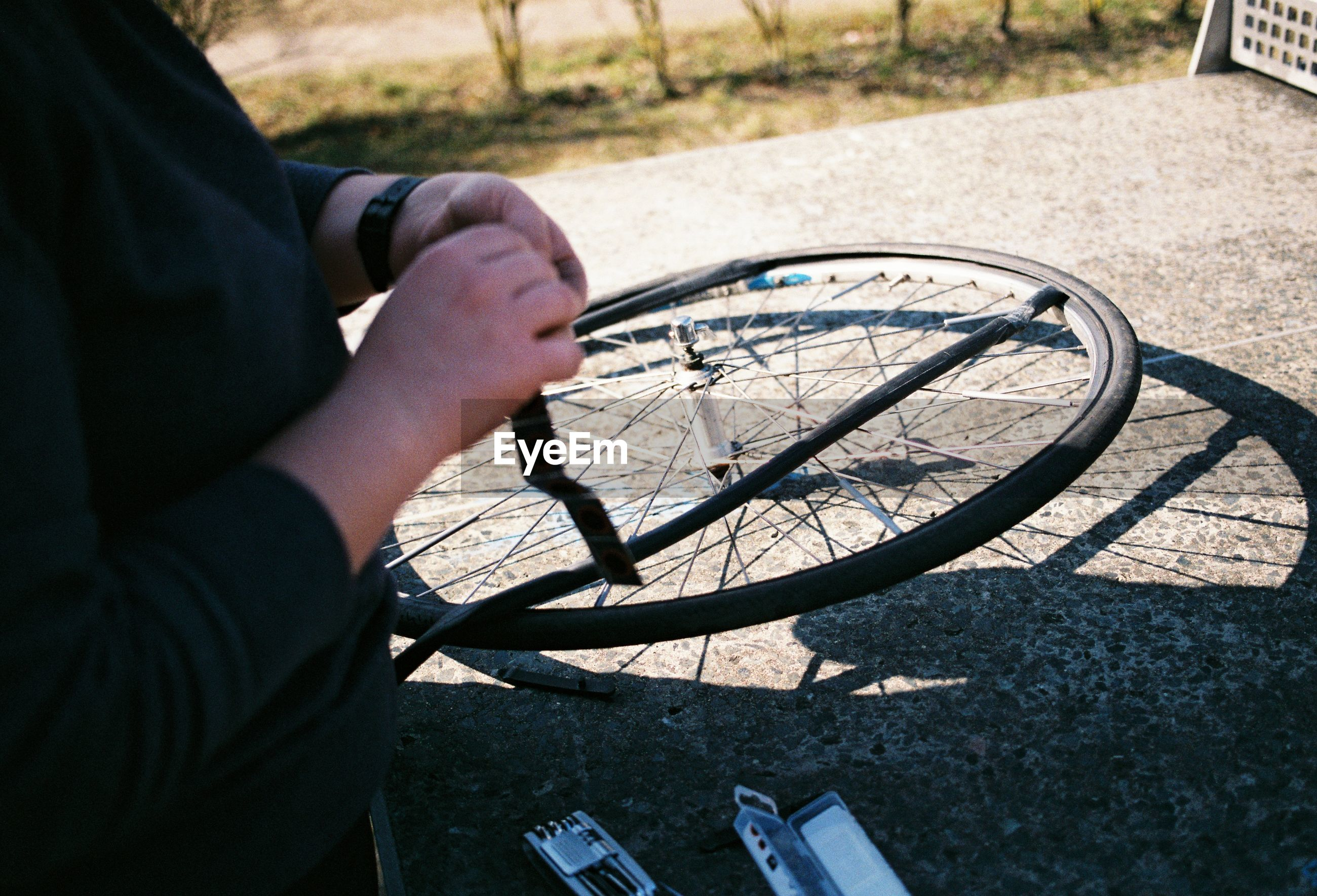High angle view of man repairing bicycle outdoors