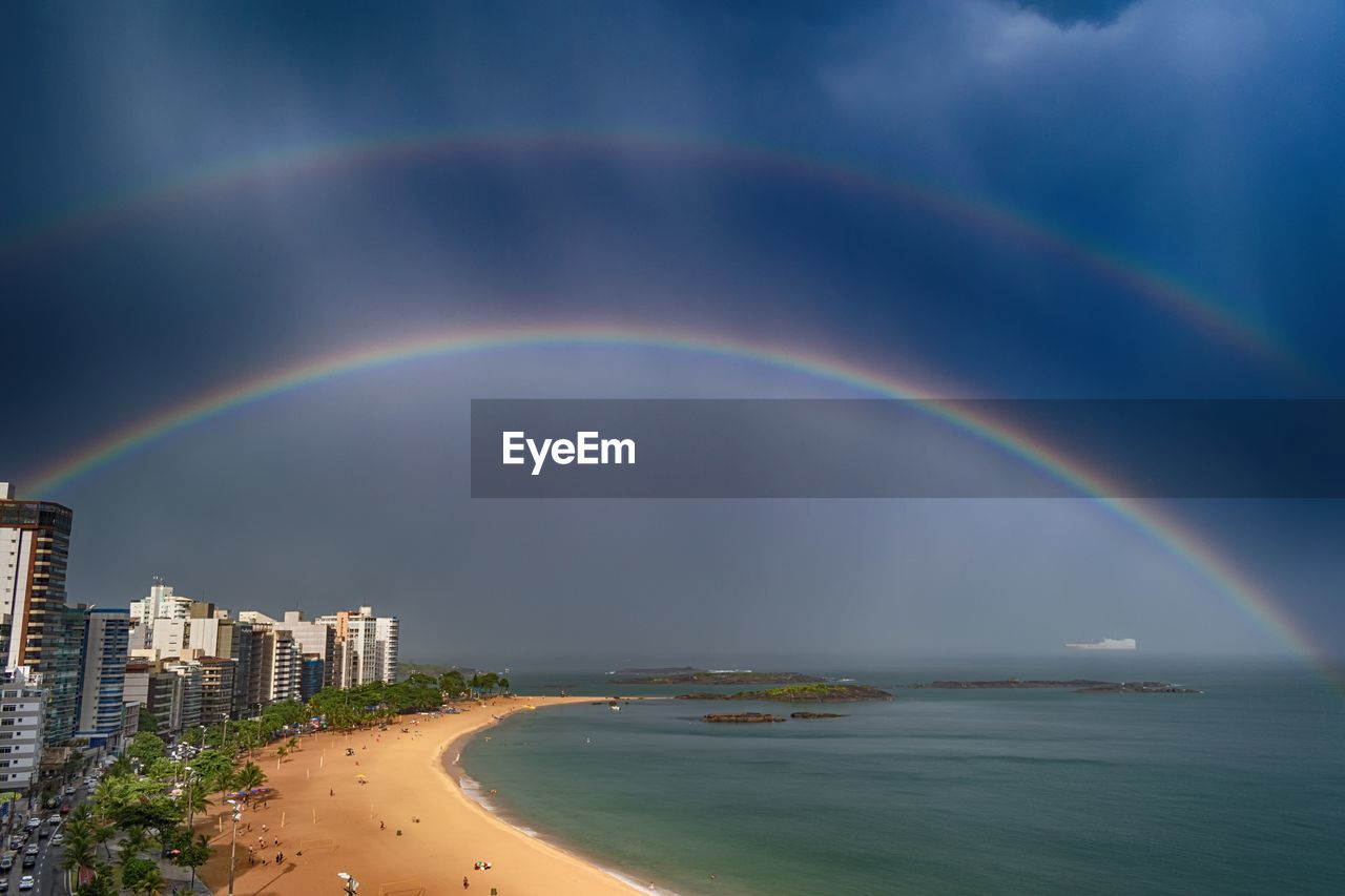 rainbow, scenics - nature, water, beauty in nature, sea, sky, double rainbow, nature, cloud - sky, idyllic, architecture, no people, beach, multi colored, tranquil scene, building exterior, land, built structure, horizon over water, outdoors, rain