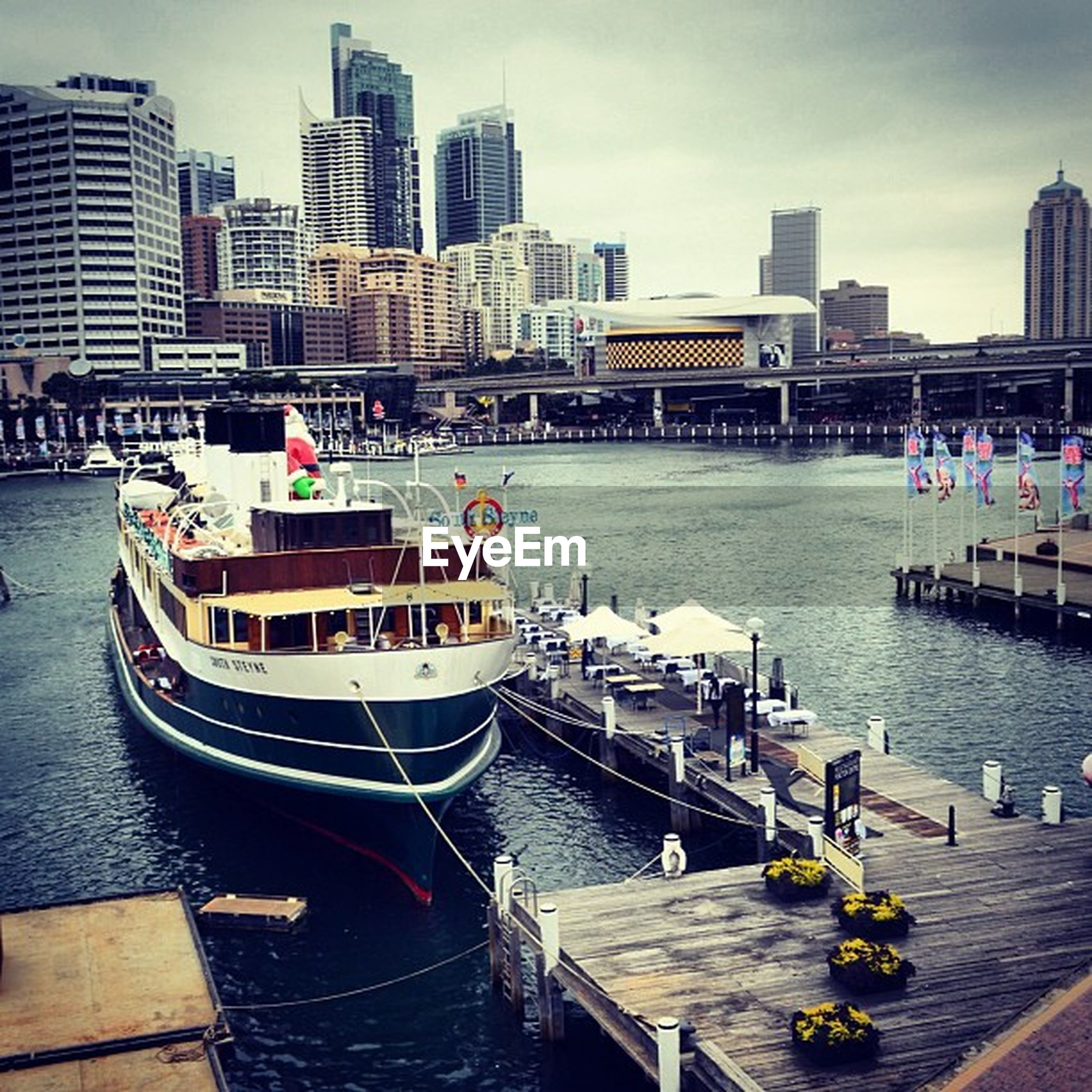 building exterior, nautical vessel, architecture, built structure, water, transportation, city, boat, mode of transport, moored, river, harbor, city life, waterfront, cityscape, sky, incidental people, sea, travel, day