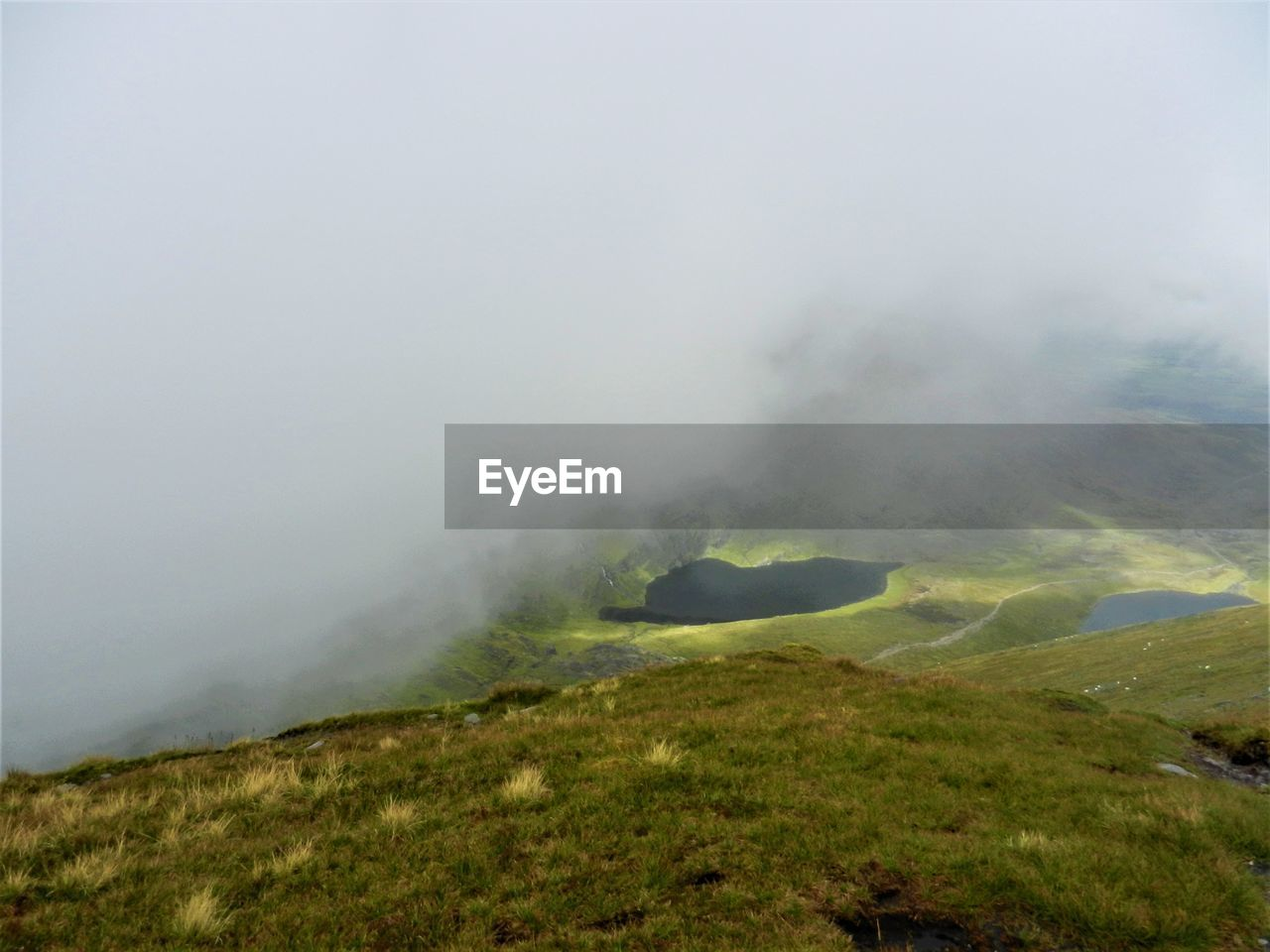 nature, beauty in nature, landscape, non-urban scene, scenics, outdoors, tranquil scene, no people, fog, day, tranquility, physical geography, grass, mountain, power in nature, sky
