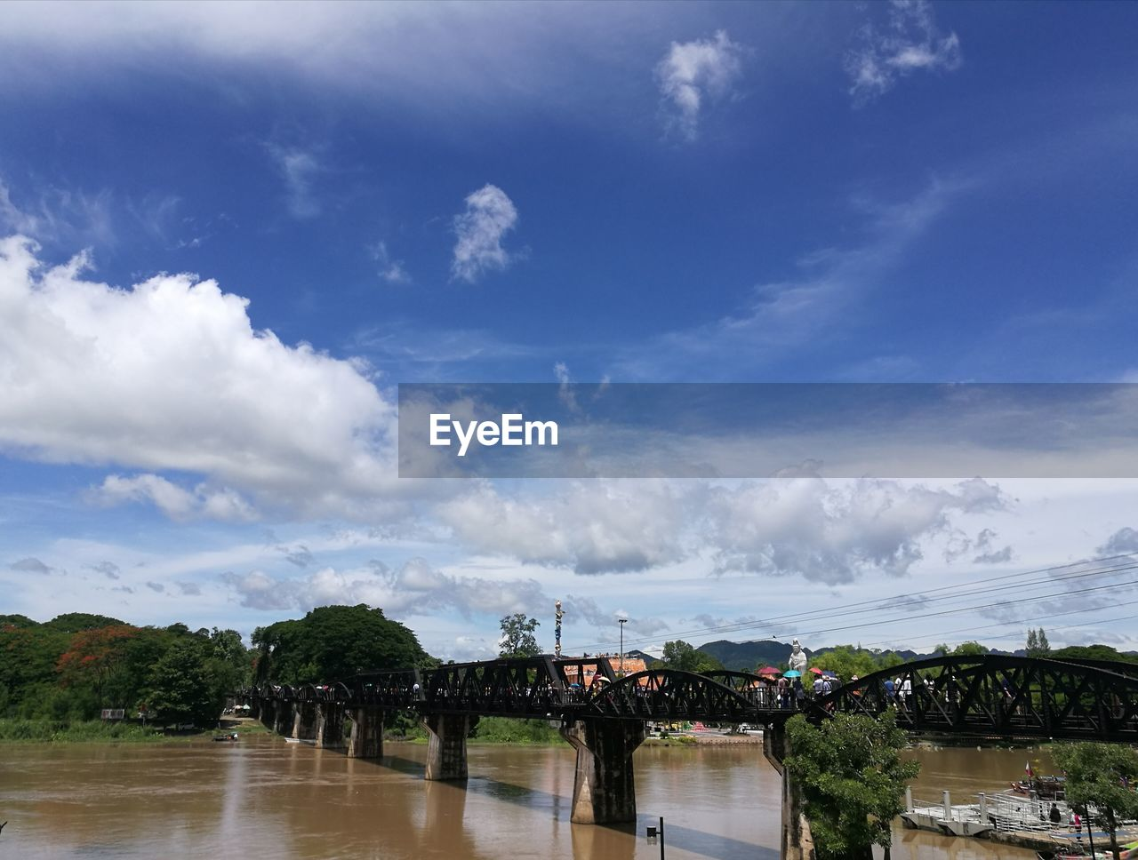 sky, cloud - sky, water, architecture, built structure, nature, tree, building exterior, bridge, connection, scenics - nature, waterfront, day, bridge - man made structure, river, no people, beauty in nature, plant, reflection, outdoors
