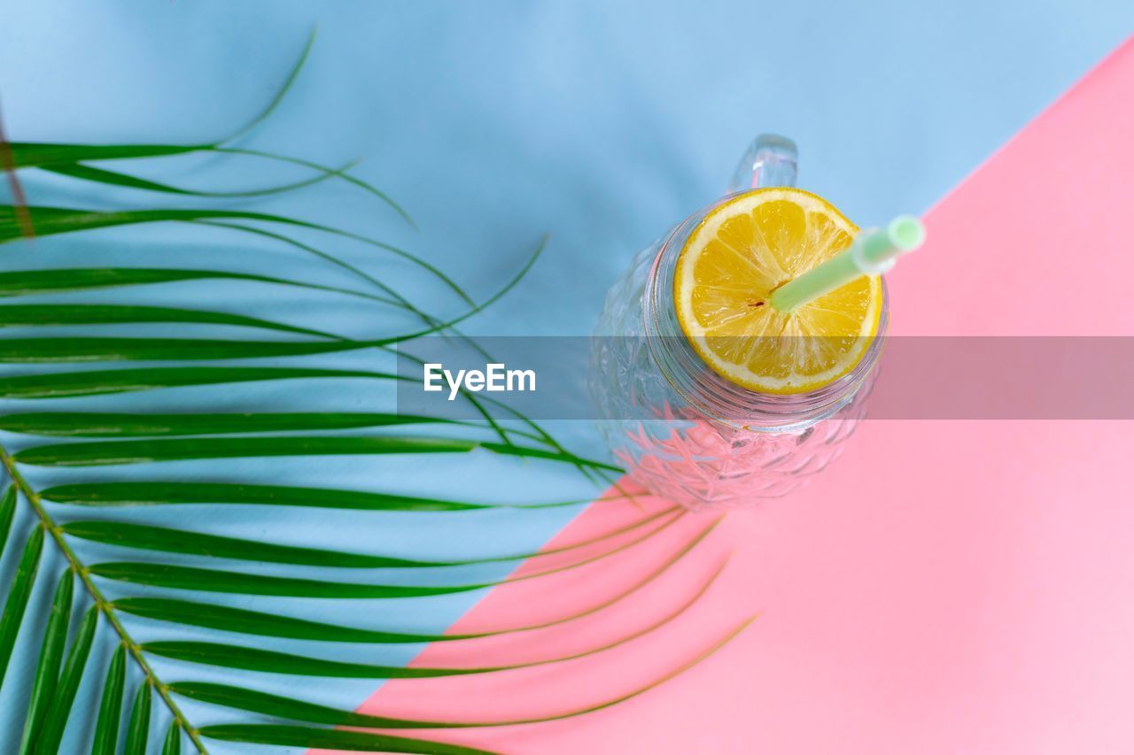food and drink, fruit, food, glass, slice, freshness, still life, healthy eating, drink, no people, drinking glass, close-up, citrus fruit, wellbeing, lemon, indoors, table, drinking straw, high angle view, refreshment, cocktail, orange