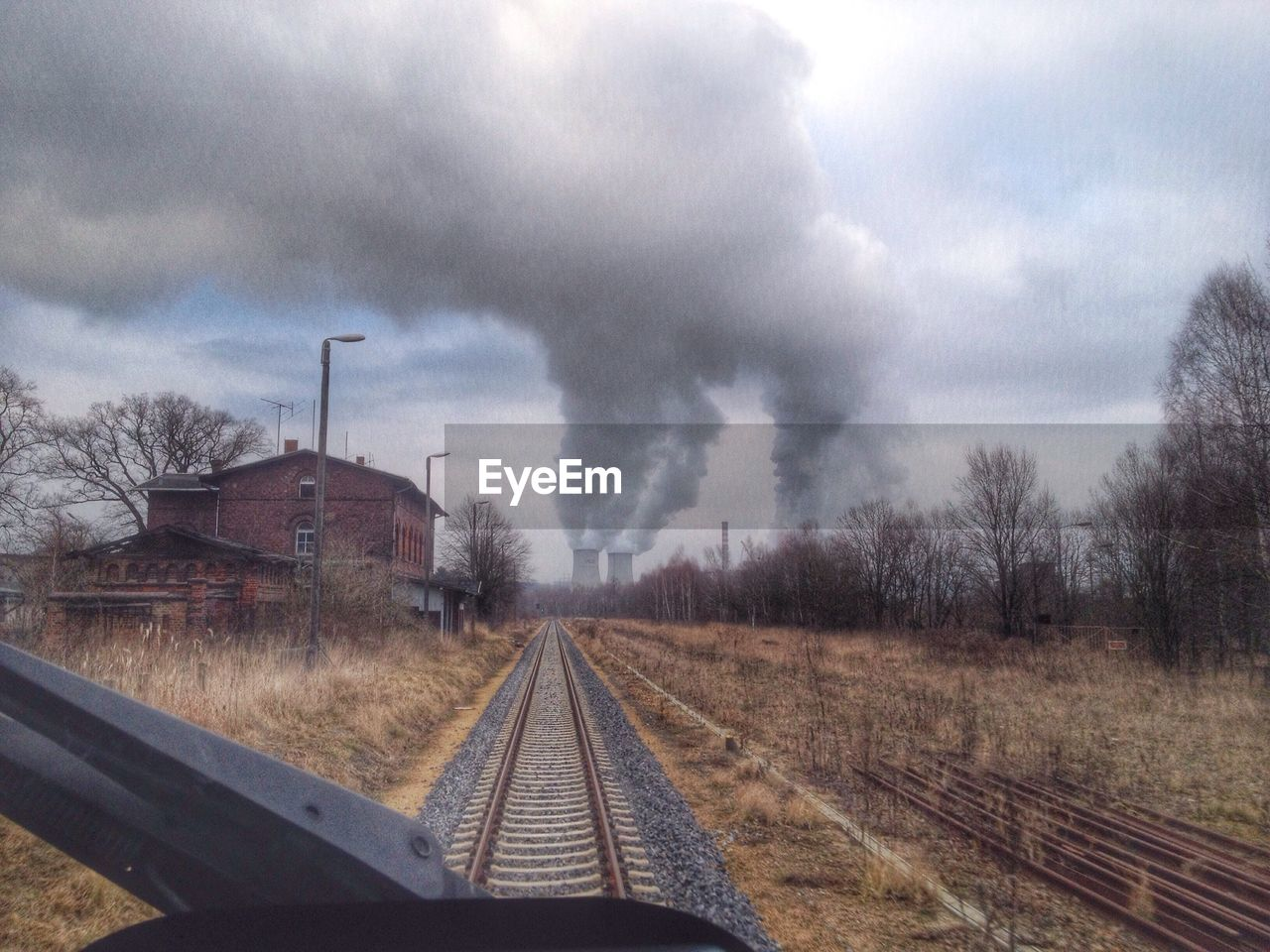 Railroad track leading towards factory