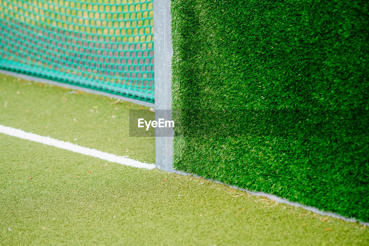 Close-Up Of Hedge By Goal Post