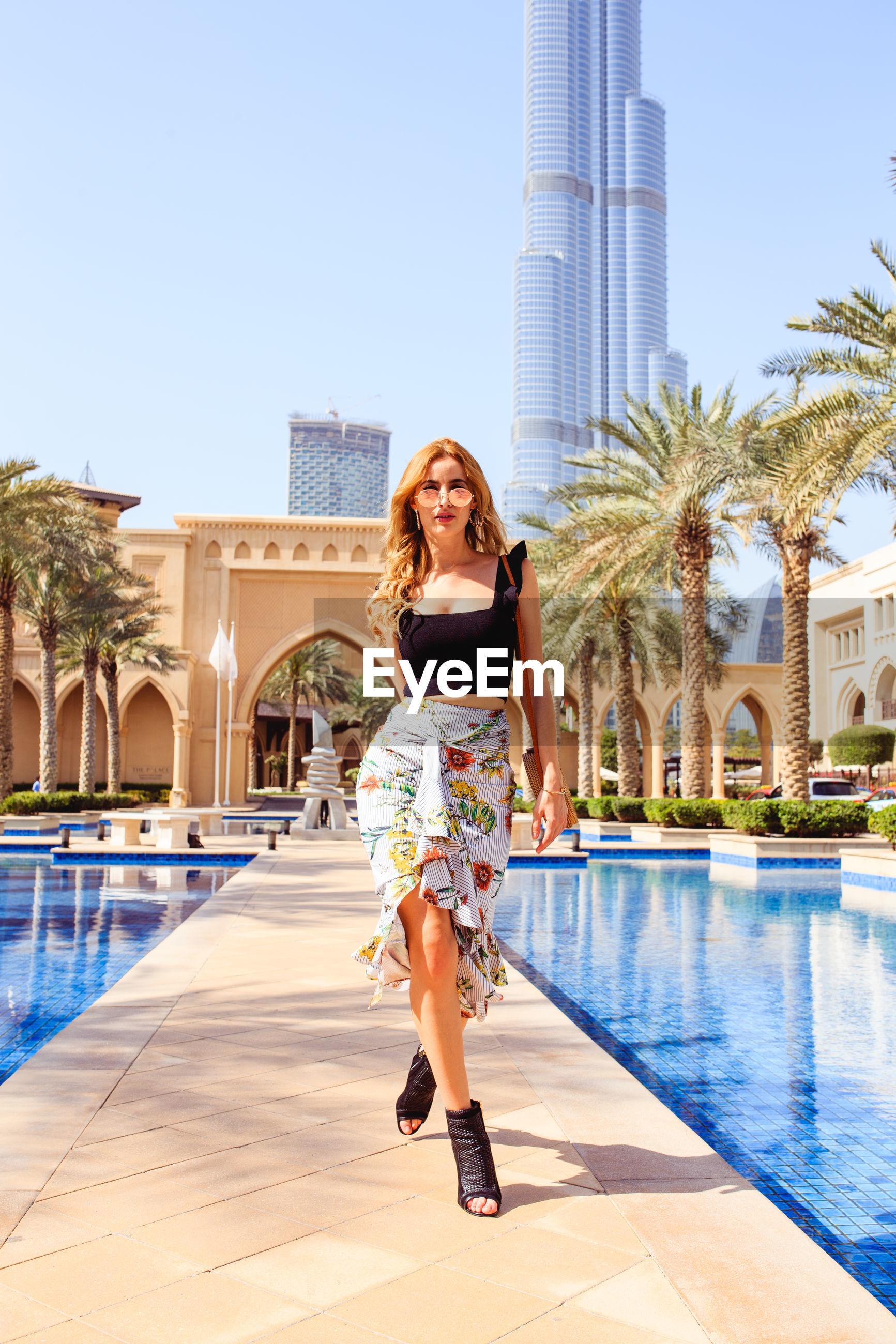 Portrait of woman walking at swimming pool