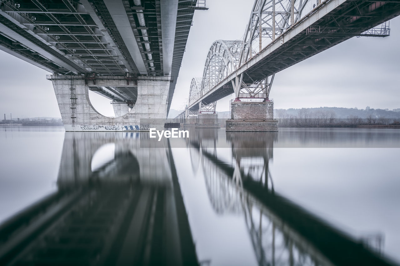 Low Angle View Of Bridge Over Seascape