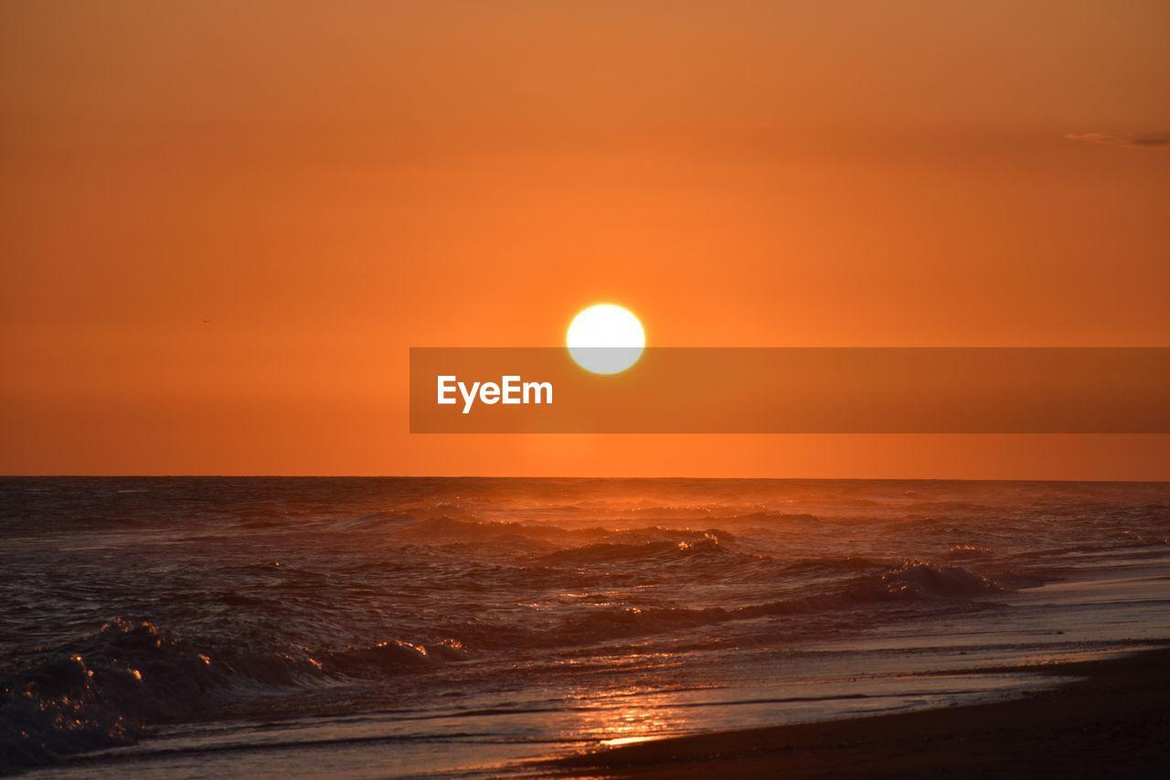 sky, sunset, beauty in nature, scenics - nature, horizon over water, sea, sun, water, orange color, horizon, tranquility, tranquil scene, idyllic, nature, beach, circle, geometric shape, no people, outdoors, astronomy
