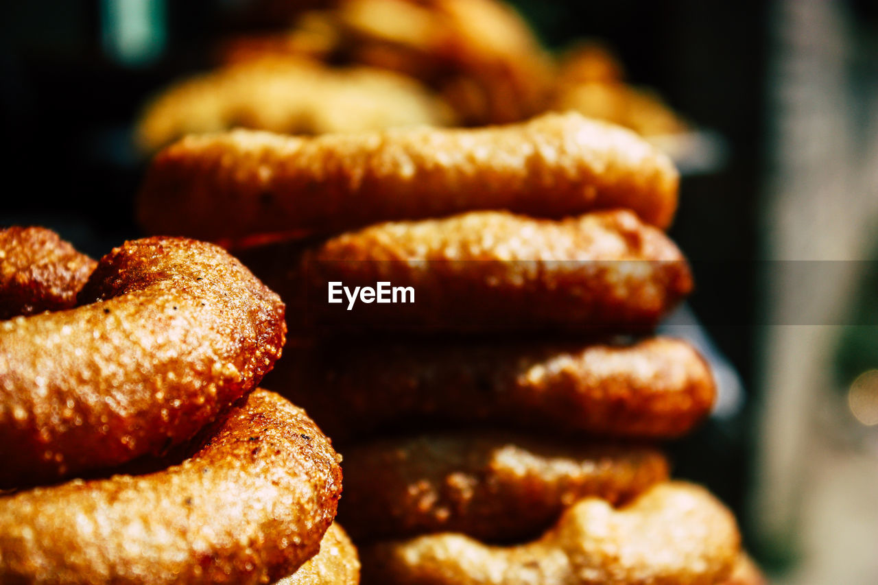 food and drink, food, still life, close-up, freshness, focus on foreground, ready-to-eat, stack, no people, fried, unhealthy eating, indulgence, indoors, baked, snack, selective focus, meat, sweet food, large group of objects, brown, temptation
