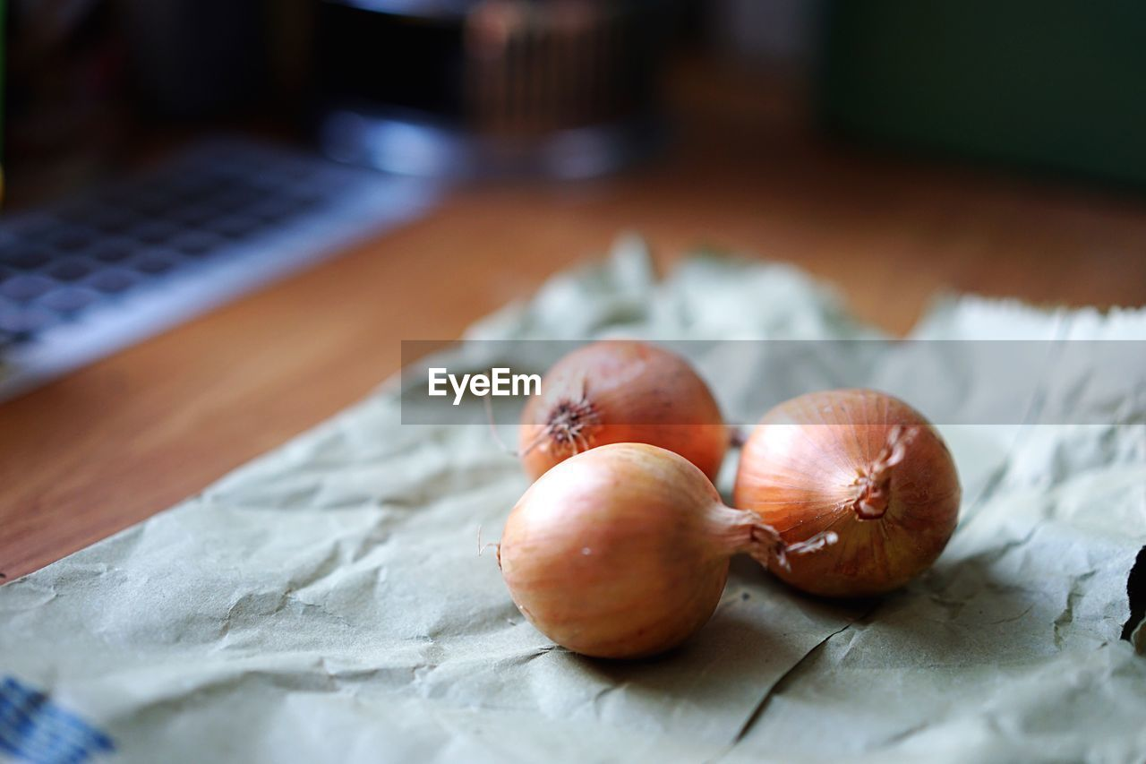 Close-Up Of Onions On Paper Bag