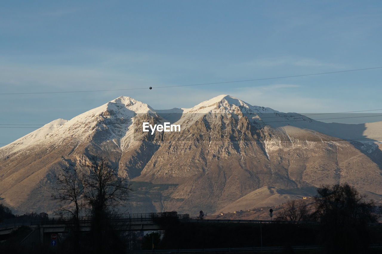 mountain, mountain range, nature, day, beauty in nature, sky, scenics, outdoors, no people, snow, landscape, peak, bird, range
