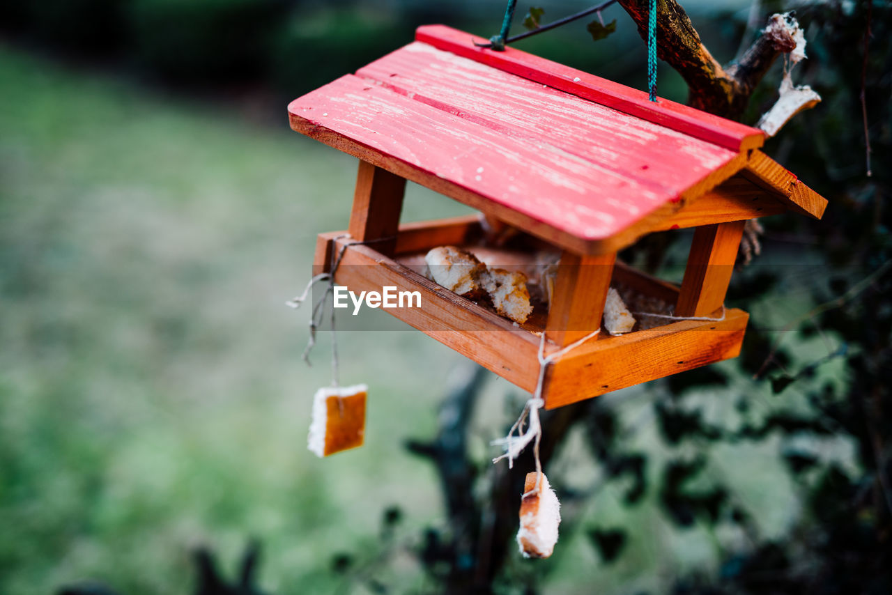Close-Up Of Wooden Birdhouse Hanging On Tree