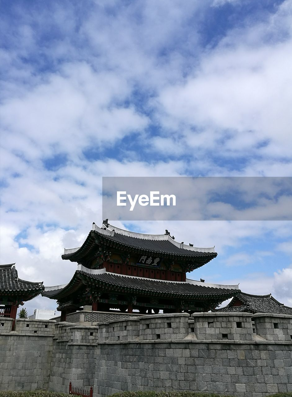 architecture, built structure, building exterior, low angle view, cloud - sky, eaves, religion, cultures, place of worship, traditional building, spirituality, sky, tradition, travel destinations, day, history, roof, no people, outdoors