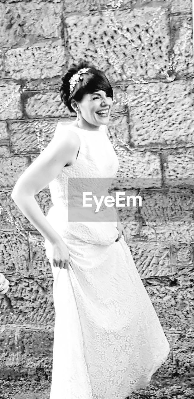 smiling, one person, real people, young adult, happiness, standing, young women, looking at camera, beautiful woman, portrait, full length, lifestyles, fashion, day, outdoors, wedding dress, bride, people