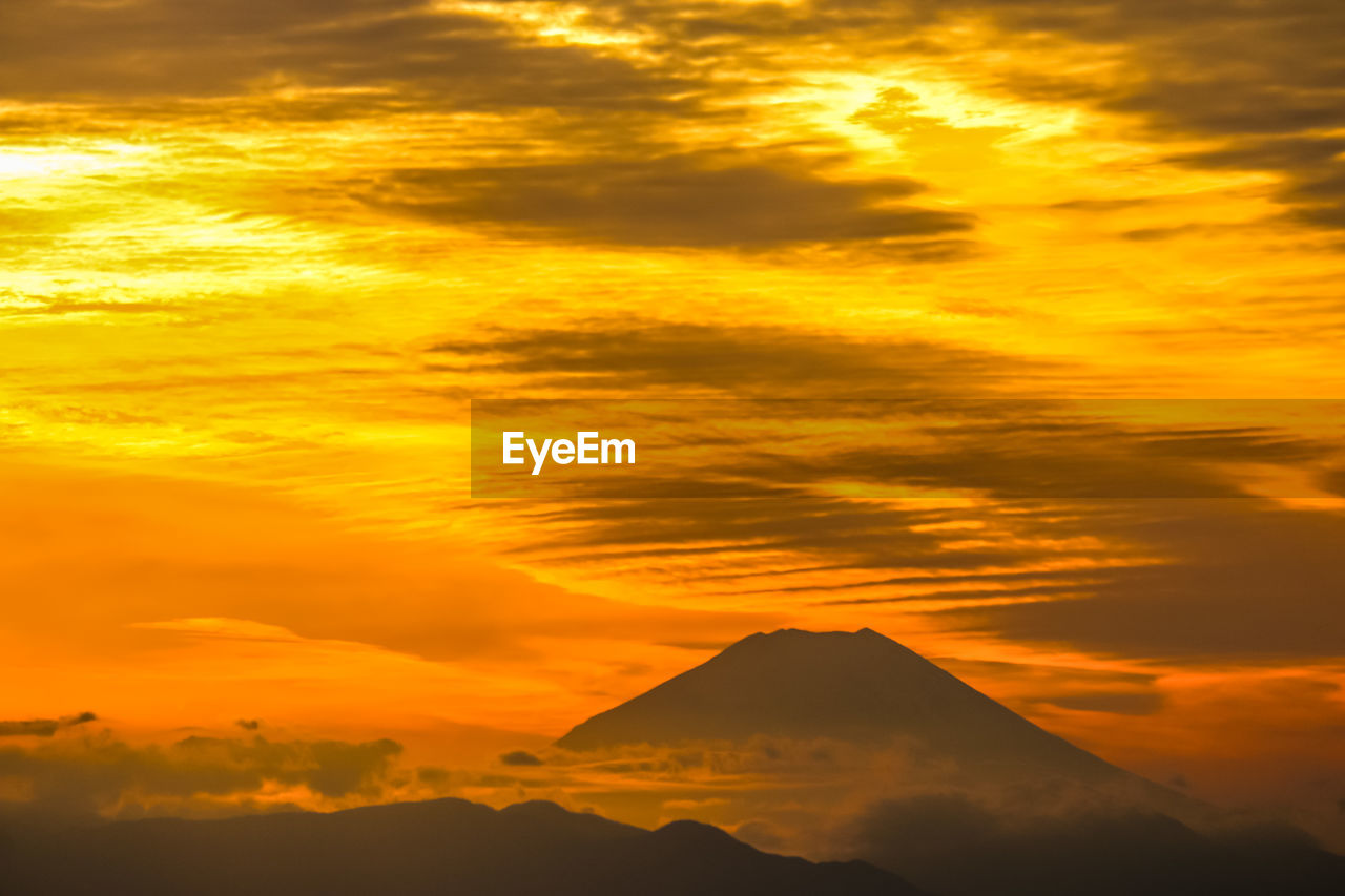 sky, sunset, cloud - sky, beauty in nature, scenics - nature, orange color, mountain, tranquil scene, tranquility, no people, nature, idyllic, silhouette, non-urban scene, outdoors, mountain peak, dramatic sky, land, majestic
