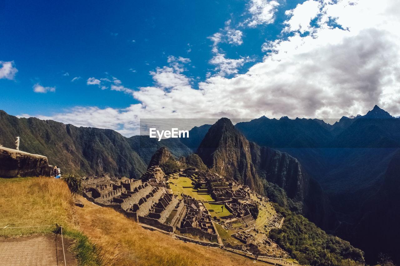 Scenic View Of Machu Picchu Against Cloudy Sky