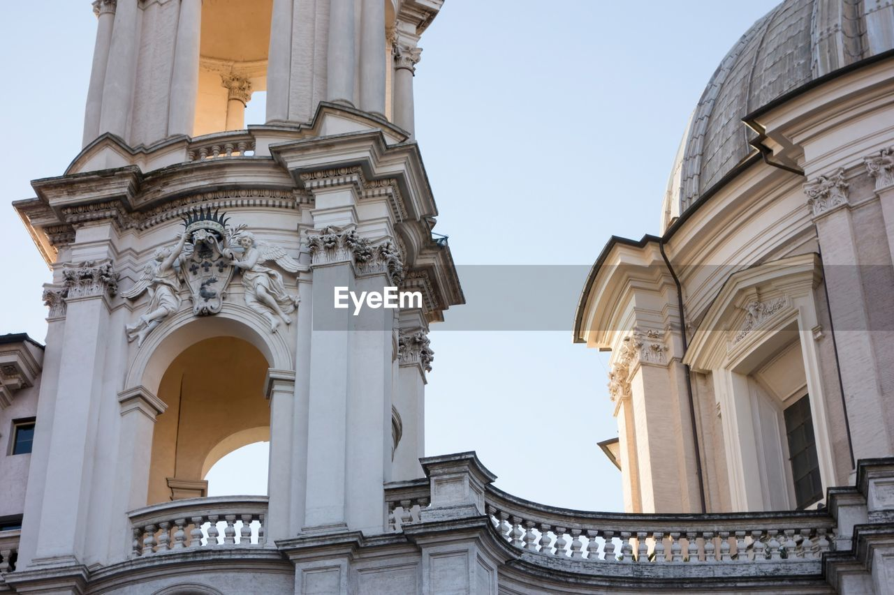 built structure, architecture, building exterior, sky, building, low angle view, the past, history, arch, place of worship, clear sky, religion, nature, spirituality, no people, belief, travel destinations, city, day, architectural column, ornate, carving