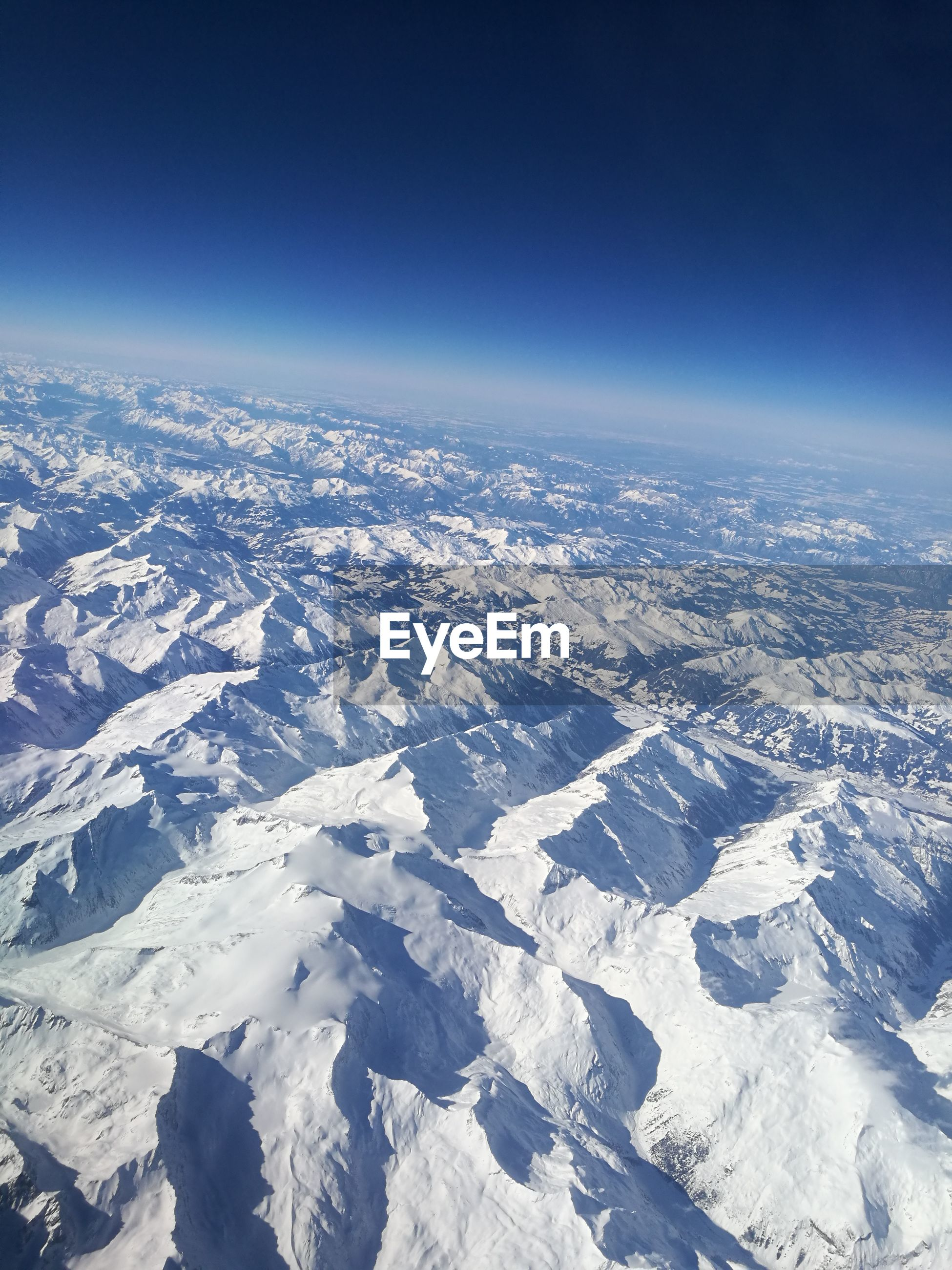 beauty in nature, nature, tranquil scene, cold temperature, scenics, tranquility, aerial view, snow, winter, no people, outdoors, landscape, day, snowcapped mountain, blue, mountain, sky