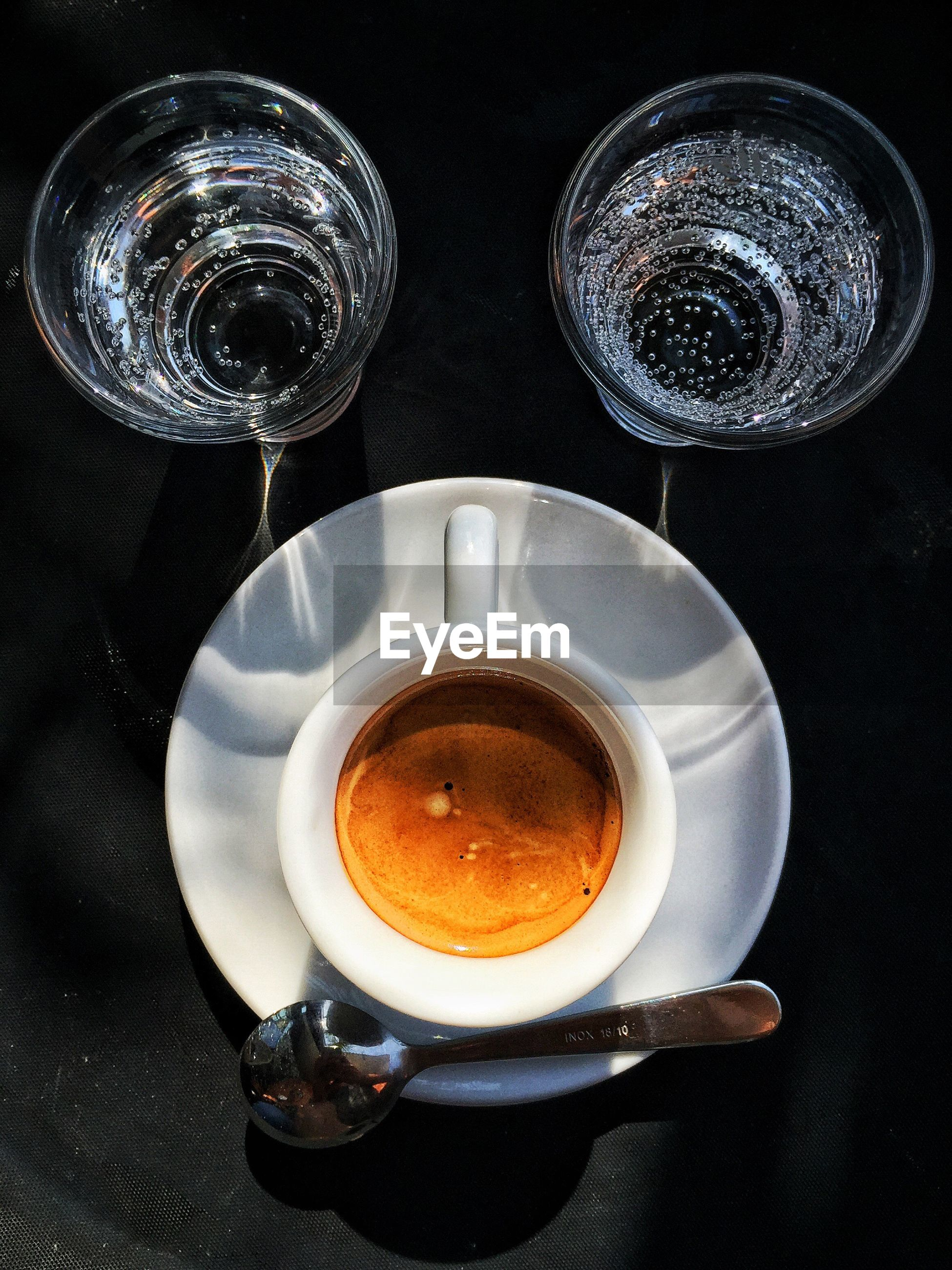 Close-up of espresso served on table