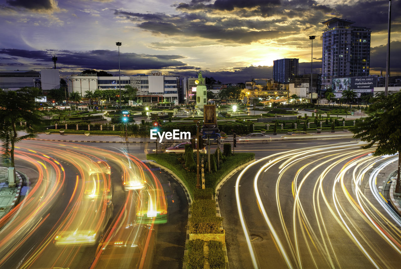 city, building exterior, illuminated, built structure, architecture, sky, cloud - sky, road, long exposure, transportation, street, motion, night, light trail, nature, city life, speed, no people, dusk, cityscape, outdoors, office building exterior, modern, skyscraper, multiple lane highway