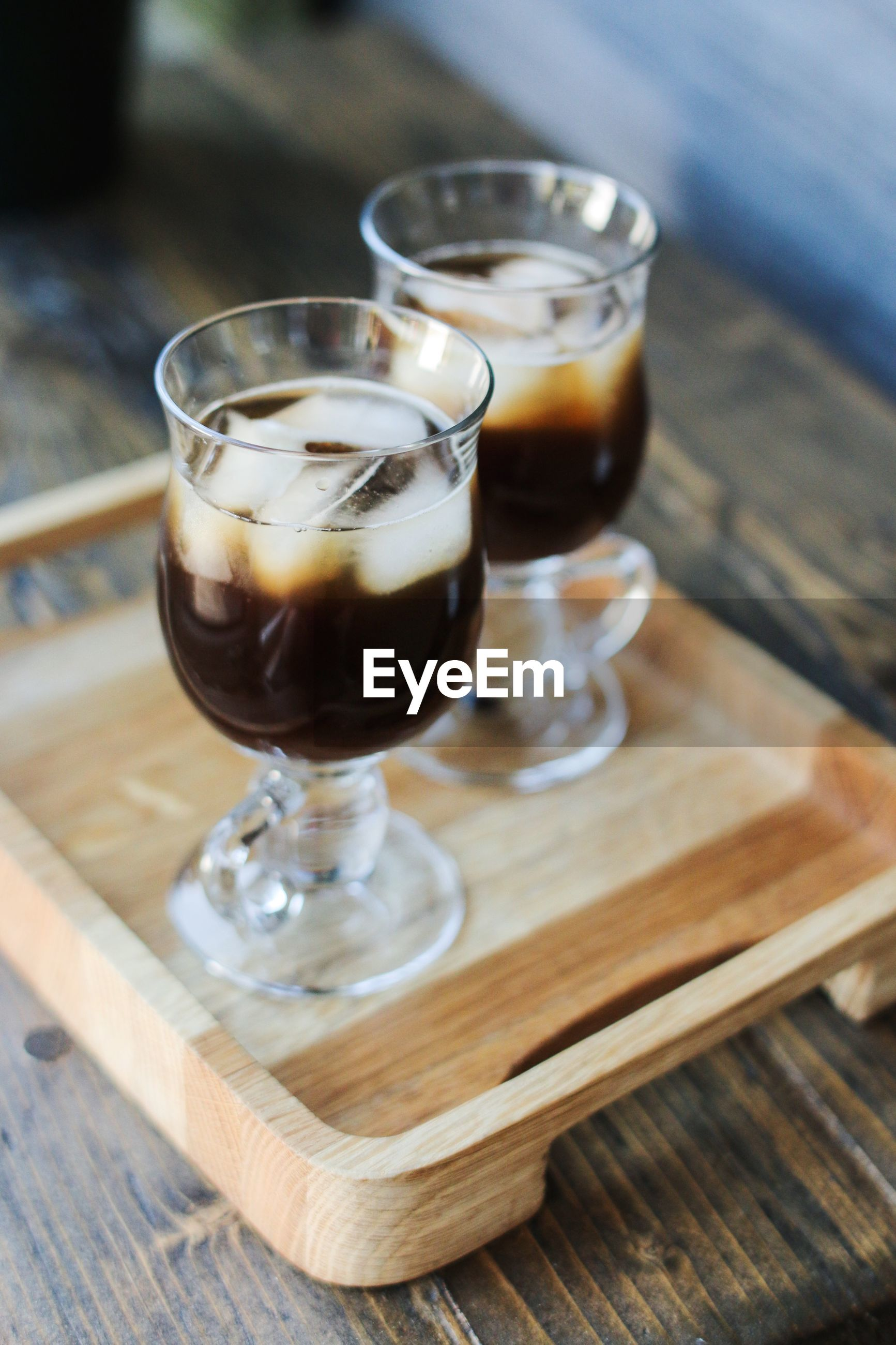 High angle view of ice coffee in glasses on table