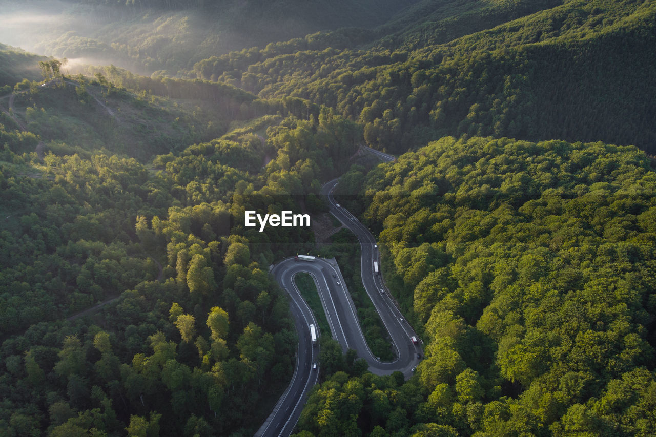 Summer aerial view of transalpina mountain road, at sunrise