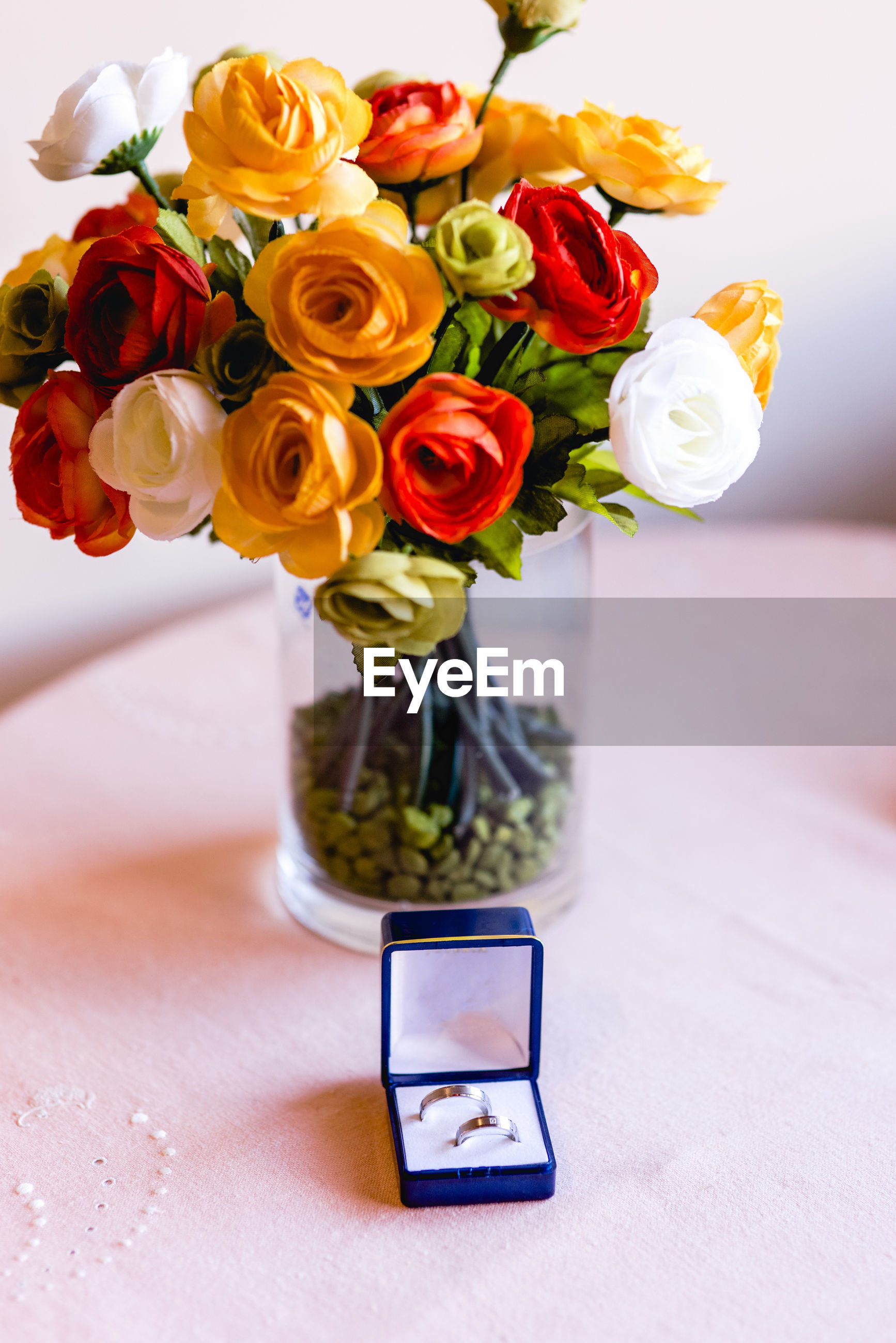 Close-up of roses in vase on table