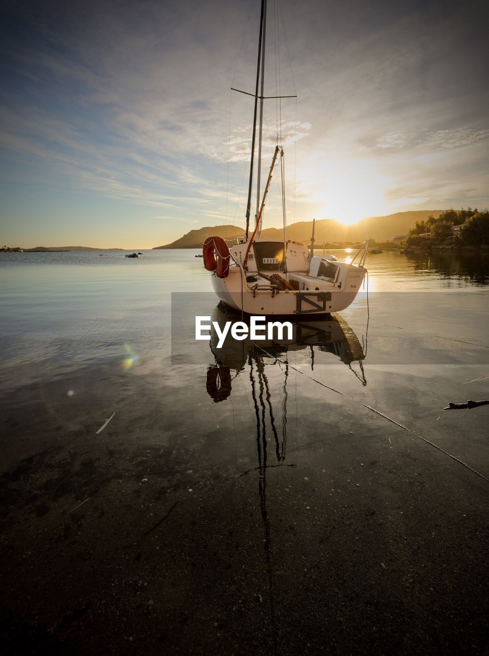 transportation, nautical vessel, mode of transport, water, boat, nature, moored, sunset, sky, beauty in nature, tranquility, sea, reflection, outdoors, scenics, cloud - sky, no people, day, outrigger