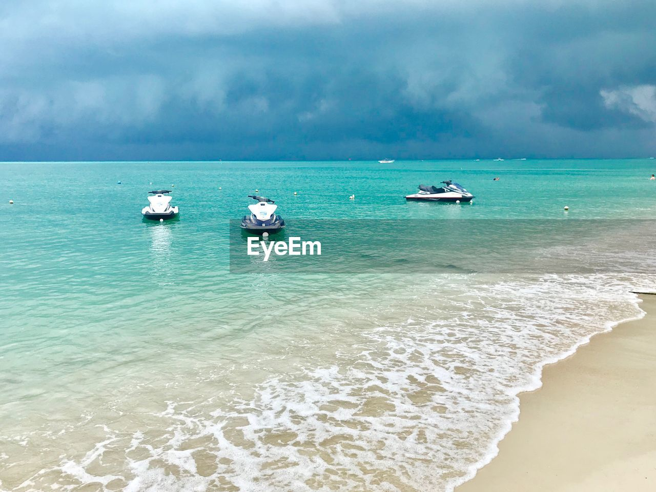 sea, water, nautical vessel, sky, beach, transportation, scenics - nature, mode of transportation, beauty in nature, land, sport, horizon over water, horizon, motion, cloud - sky, nature, day, wave, surfing, turquoise colored, outdoors