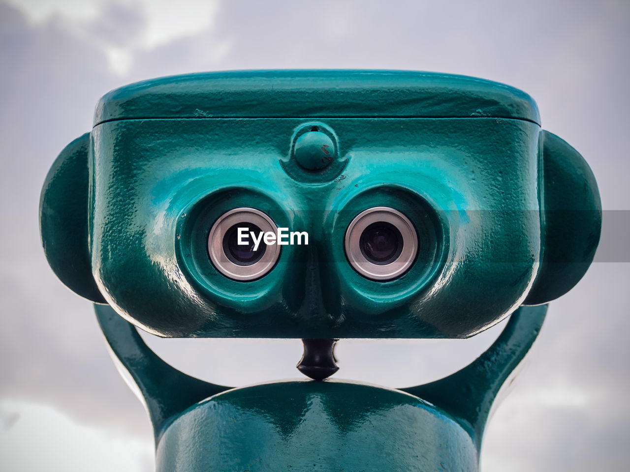 Close-Up Of Coin-Operated Binoculars Against Cloudy Sky