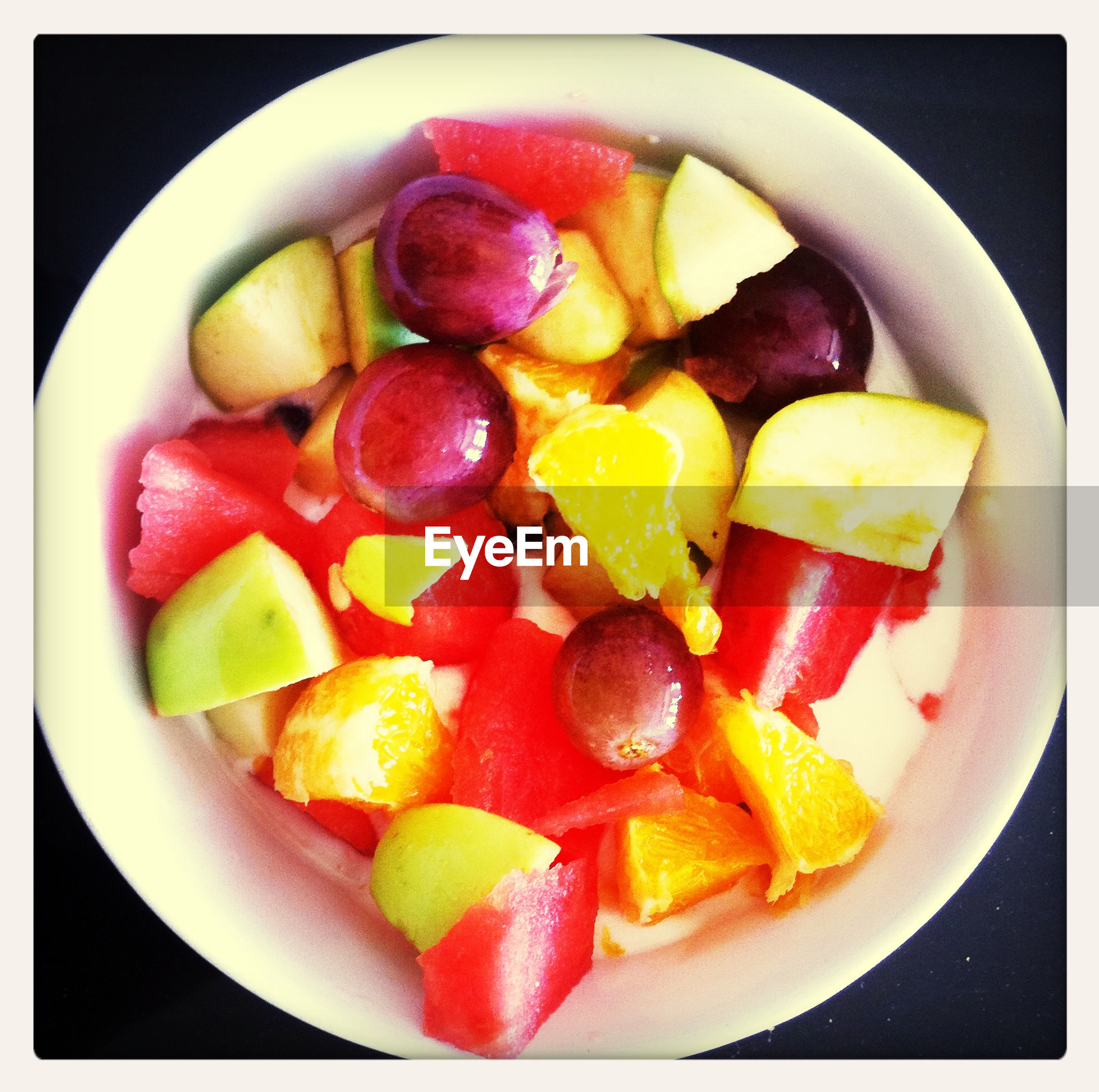 Close-up of fruit salad served on table