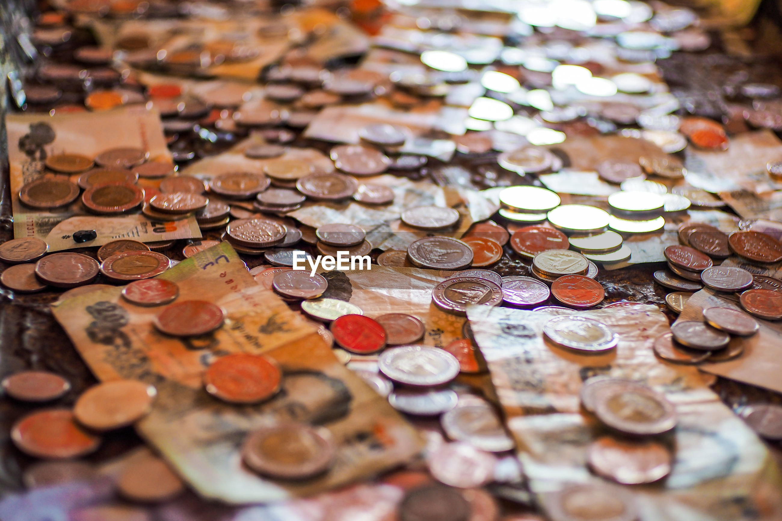 Full frame shot of paper currency and coins