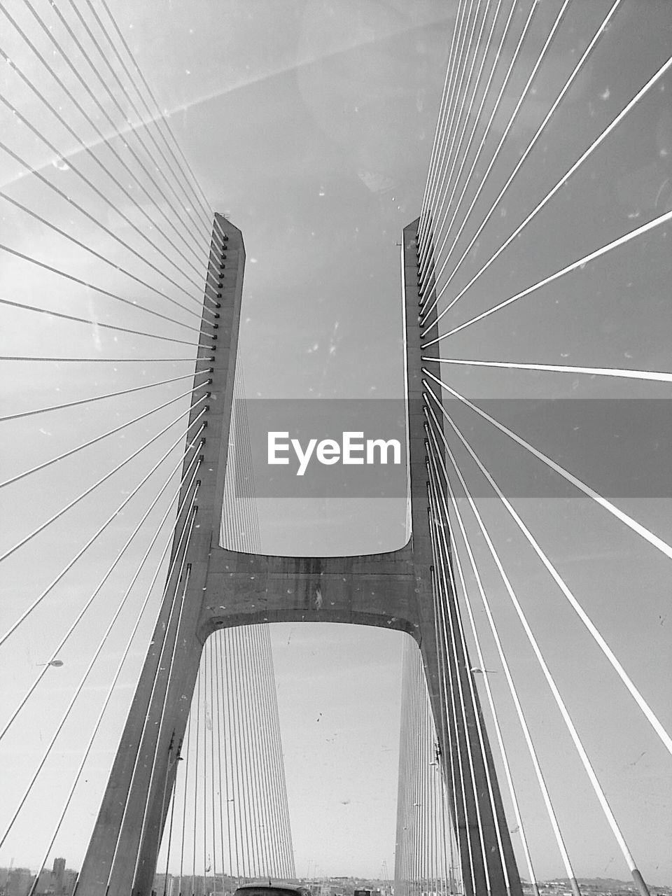 connection, bridge - man made structure, architecture, suspension bridge, built structure, bridge, transportation, low angle view, city, outdoors, day, no people, line, modern, sky