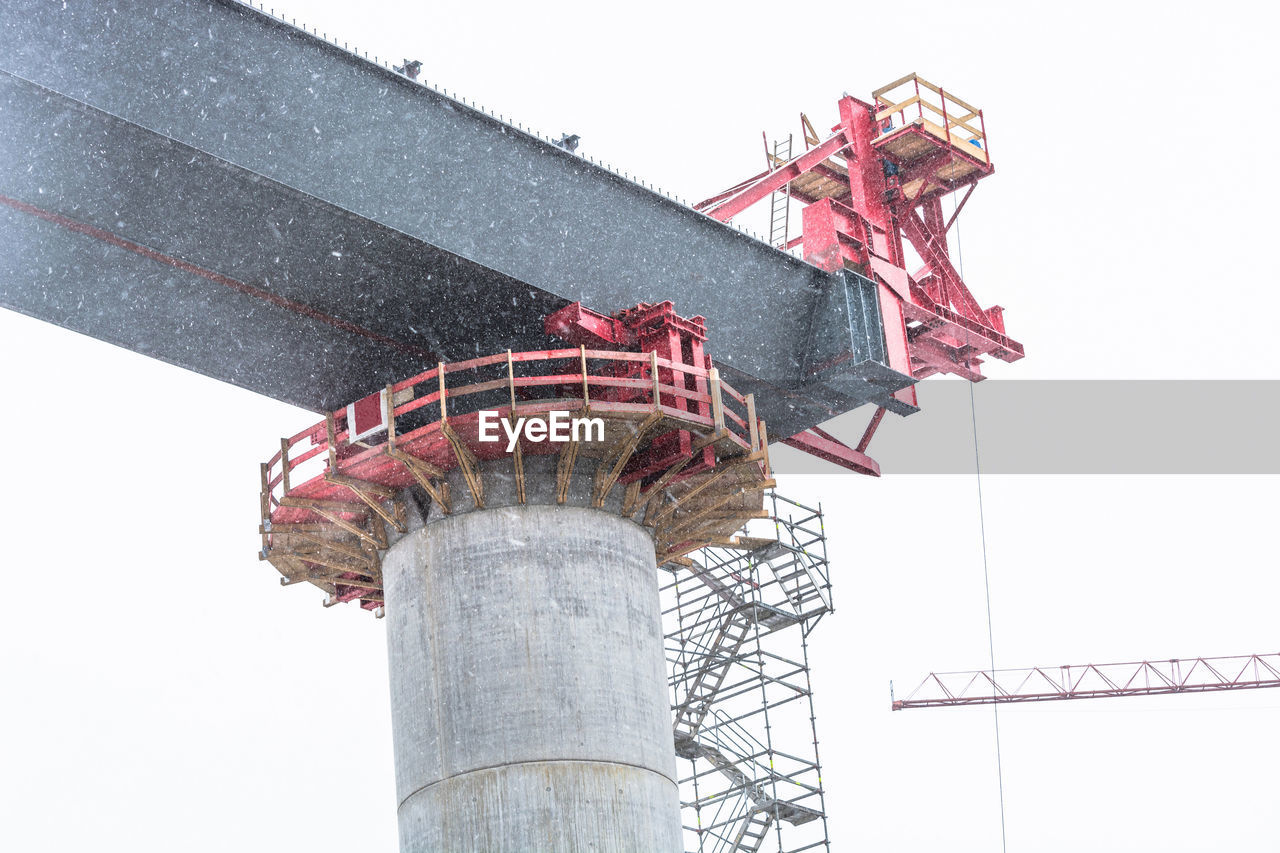 built structure, low angle view, architecture, sky, nature, industry, construction industry, day, machinery, development, construction site, no people, outdoors, building exterior, metal, clear sky, connection, crane - construction machinery, technology, copy space