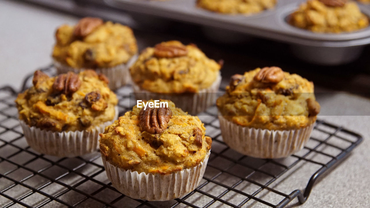 Close-up of muffins on cooling rack