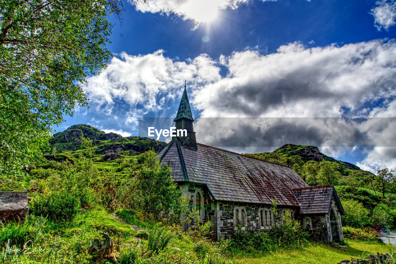 sky, architecture, built structure, plant, building exterior, cloud - sky, building, religion, tree, place of worship, nature, belief, spirituality, day, land, no people, house, mountain, outdoors, spire