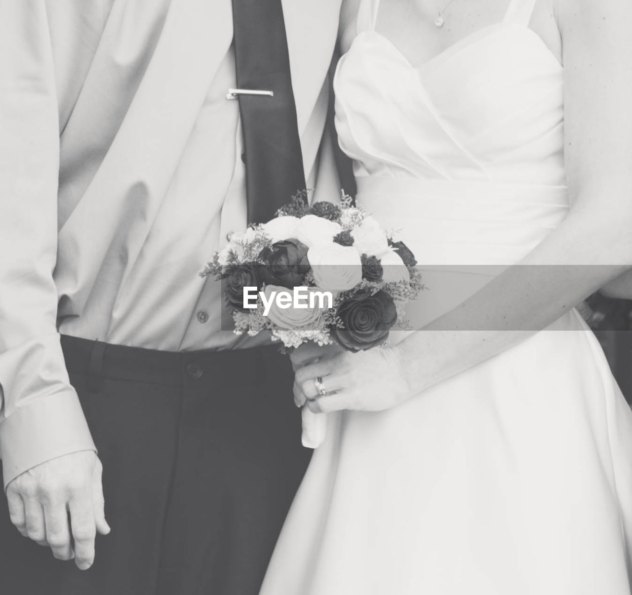 midsection, holding, real people, celebration, wedding, life events, adult, bride, women, standing, newlywed, front view, religion, flower, event, ceremony, bridegroom, people, married, two people, bouquet, hand, flower arrangement, wedding ceremony, positive emotion, couple - relationship
