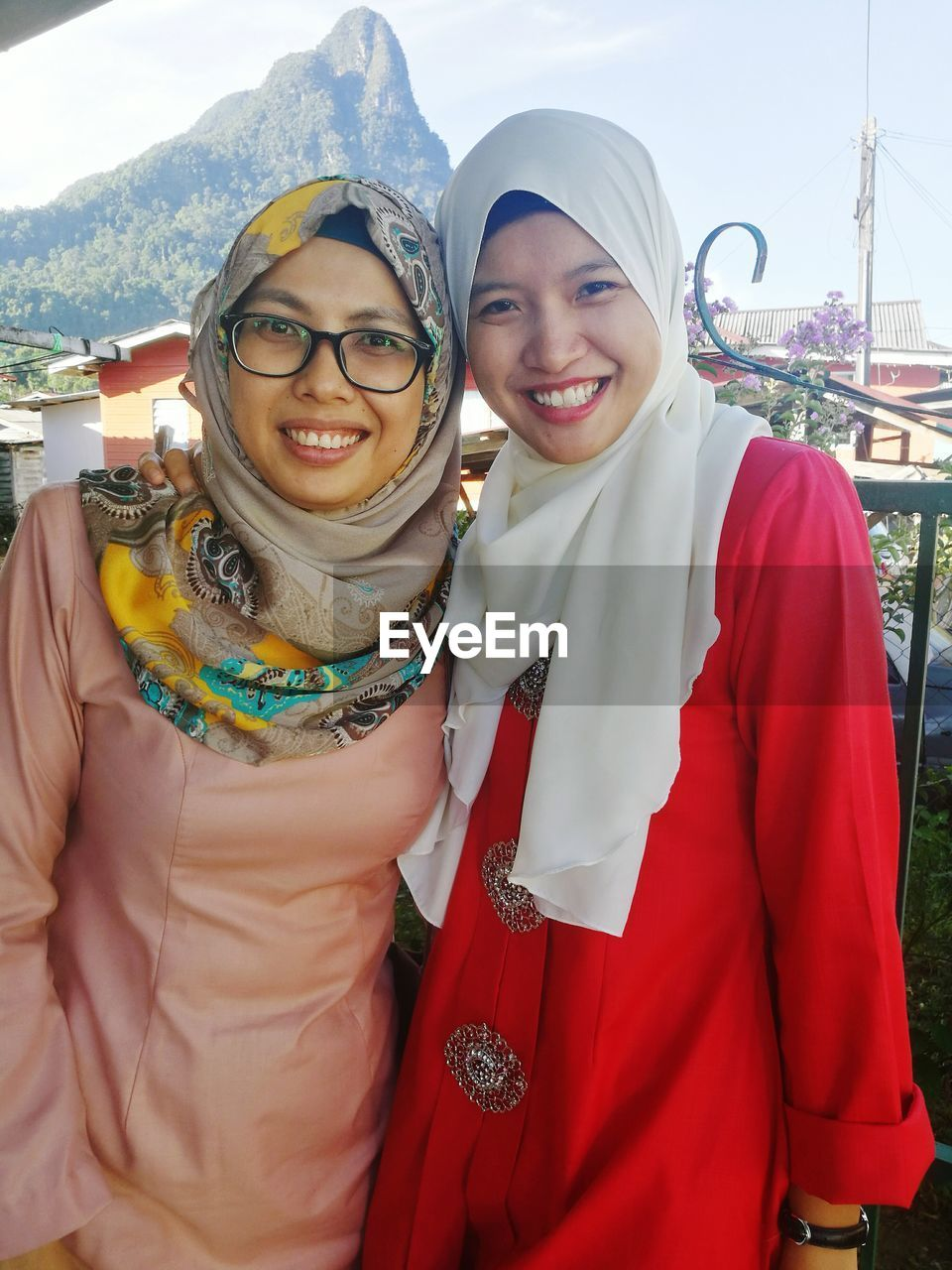 real people, looking at camera, traditional clothing, smiling, lifestyles, togetherness, happiness, portrait, standing, leisure activity, two people, outdoors, young women, day, front view, young adult, celebration, bonding